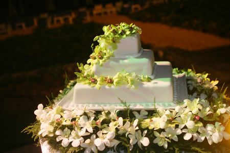 Wedding cake decorated with white orchids. photo