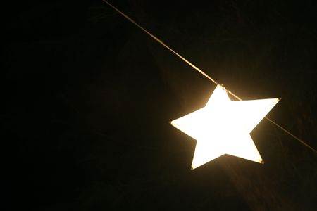 nite: Star shaped light hanging up on a calm evening.