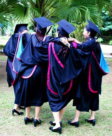 Beautiful Asian university graduate on graduation day. photo