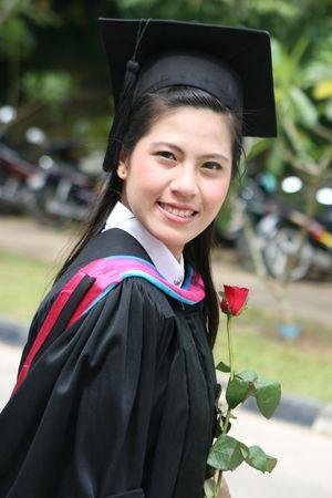 Happy Asian university graduate. photo