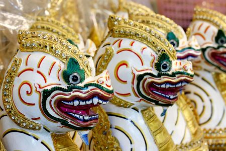 Close-up image of colorful Asian handmade masks. photo