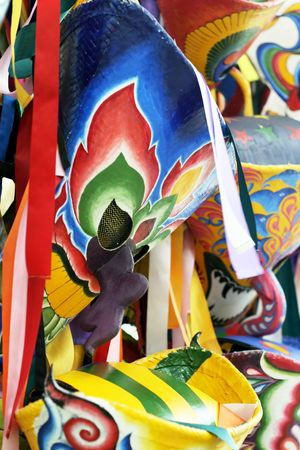 Close-up image of a colorful handmade mask. photo