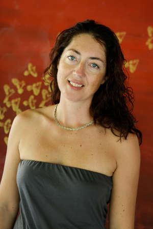 Portrait of a pretty brunette woman in a summer dress. Stock Photo - 4766906