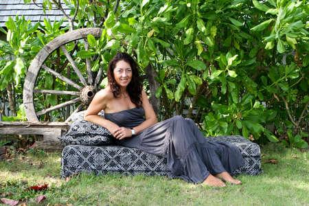 Portrait of a pretty brunette woman in a summer dress. photo