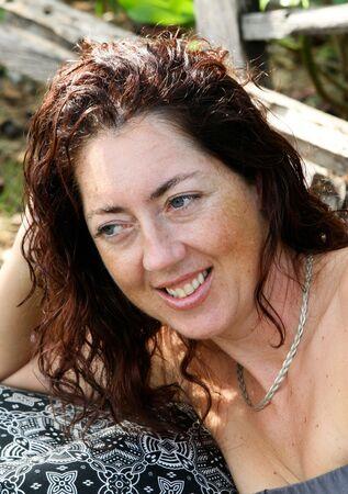Close-up portrait of a pretty brunette woman. photo