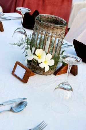 homeware: Close-up of a candle at a wedding reception.