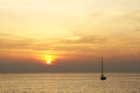 Beautiful scenic view of a yacht on the ocean at sunset. photo