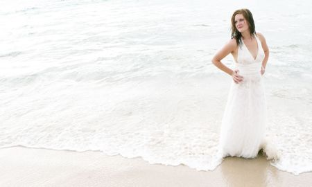 Portrait of a beautiful bride on the beach. photo