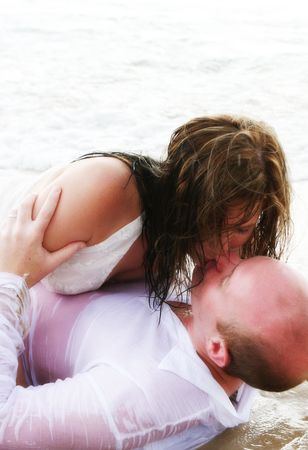 Attractive young bride and groom on the beach. photo