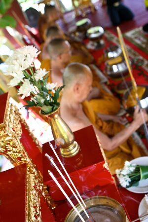 Monks chanting at a Thai temple. photo