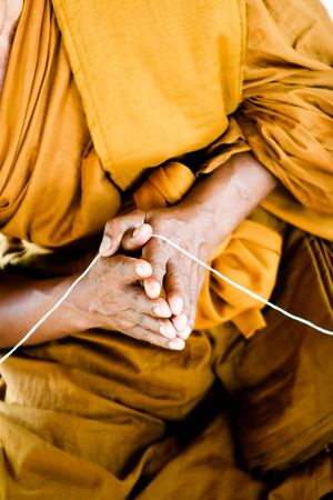 Close-up of a Thai monk at a temple in Thailand - travel and tourism. photo