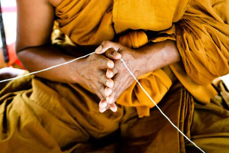 Close-up of a Thai monk at a temple in Thailand - travel and tourism. Stock Photo - 4801593