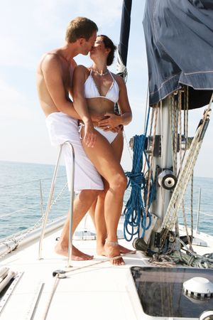 beach cruiser: Happy couple relaxing on a luxury yacht.
