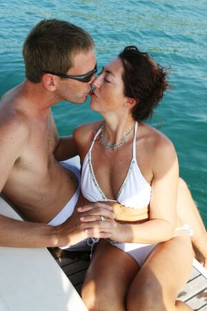 tour boats: Happy couple relaxing on a luxury yacht.
