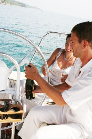 Happy bride and groom on a luxury yacht. photo