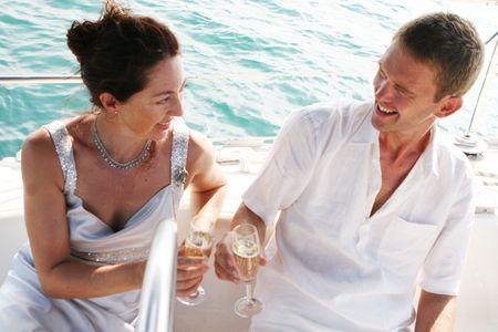 destination wedding: Happy bride and groom on a luxury yacht.