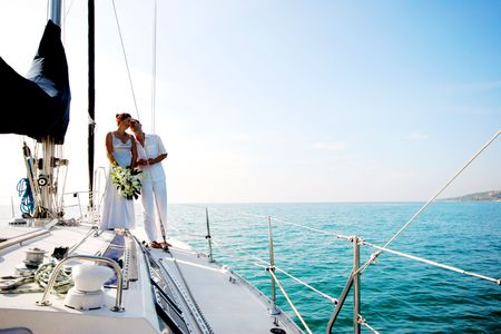 Happy couple relaxing on a luxury yacht.