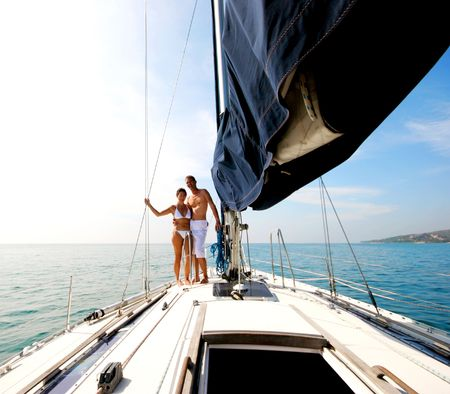 Happy couple relaxing on a luxury yacht. photo