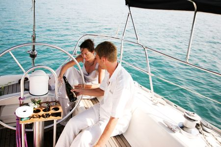 Happy bride and groom on a luxury yacht.