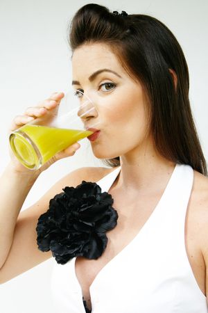 Pretty brunette woman with a glass of juice. 스톡 콘텐츠