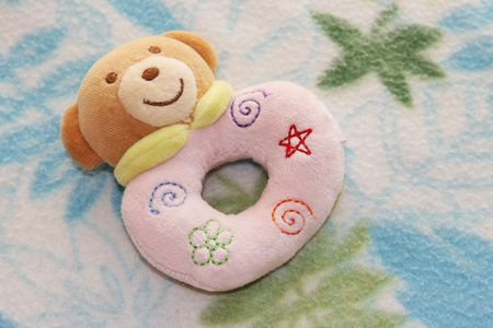s toy rattle on a blanket. Stock Photo - 5128829