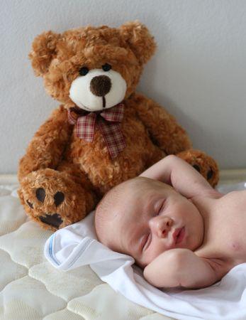 Cute newborn baby with a teddy bear. Stock Photo