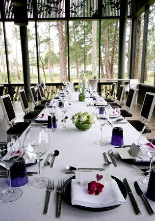 Formal table setting at a wedding reception. photo
