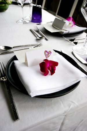 candle light table setting: Formal table setting at a wedding reception.