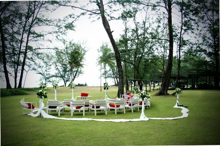 Seating arrangement decorated with flowers at a wedding ceremony outdoors. photo