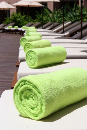 Close-up of towels at a luxury swimming pool at a tropical resort spa. Stock Photo