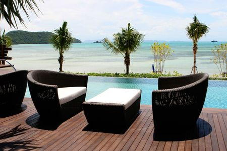 designer chair: View of the ocean from a tropical resort spa.