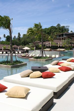 Luxury swimming pool at a tropical resort spa. photo