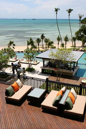 Aerial view of the ocean from a tropical resort spa.