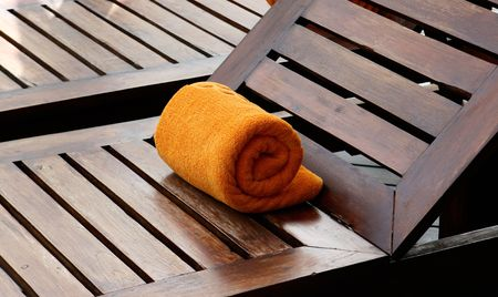 Close-up of towels at a luxury swimming pool at a tropical resort spa. Stock Photo - 5326304
