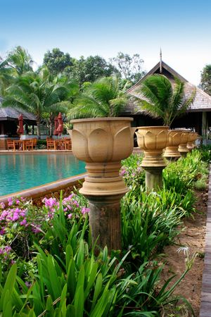 garden furniture: Swimming pool at a tropical resort in Thailand - travel and tourism.