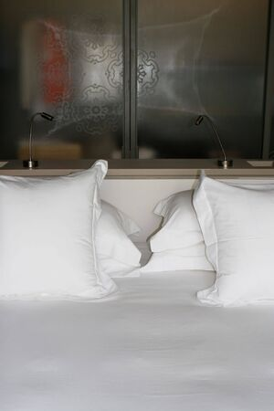 Close-up of a bed with white linen - home inters. Stock Photo - 5433470
