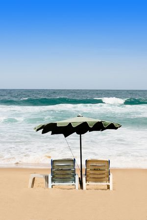 Deck chairs and umbrellas overlooking the ocean. Stock Photo - 5467503