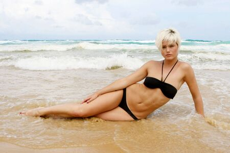 Portrait of a beautiful blond woman at the beach. photo