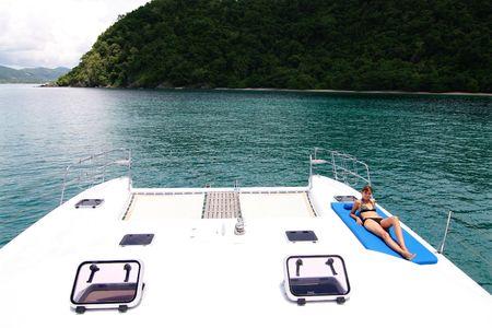aboard: Beautiful woman aboard a luxury yacht charter.