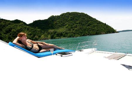 beach cruiser: Woman on a yacht.