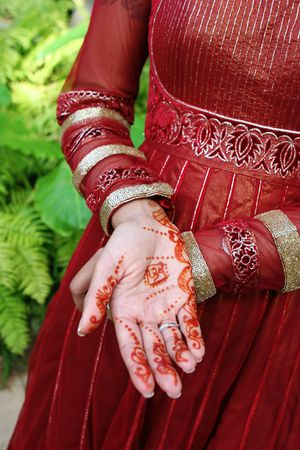 Close-up of an Indian brides hands decorated with henna.  photo