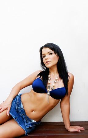 Beautiful young woman in a bikini. photo