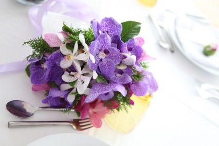 Tables decorated for a wedding reception. photo