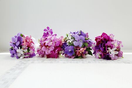 Gorgeous wedding bouquets made with bright orchids and tropical flowers. photo