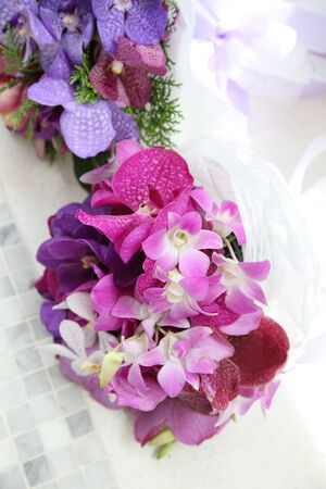 flower market: Gorgeous wedding bouquets made with bright orchids and tropical flowers.