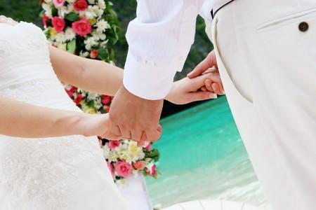 destination wedding: Bride and groom on the beach on their wedding day. Stock Photo
