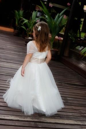 bridesmaid: Cute little bridesmaid in a white dress.