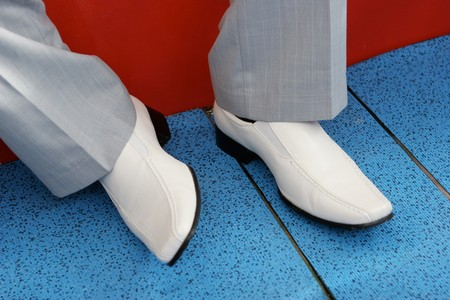 Close-up of a grooms leather shoes - wedding day. photo