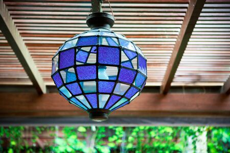 Blue glass light hanging from the ceiling. Stock Photo - 8780438