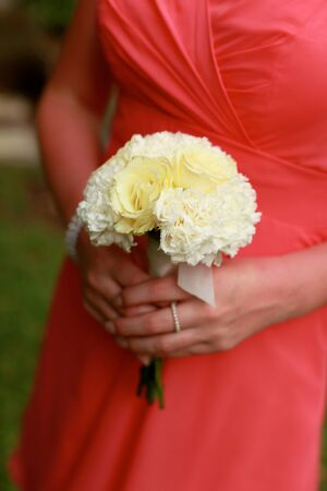 Close-up of a bridesmaid holding her wedding bouquet  photo